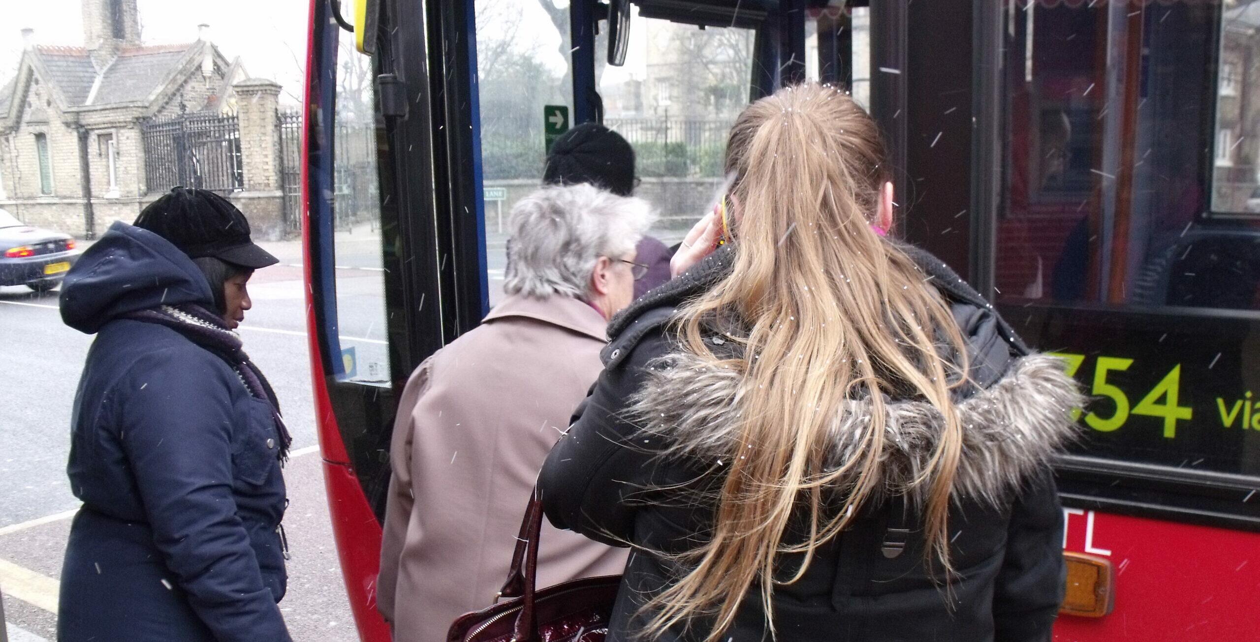 passengers entering bus