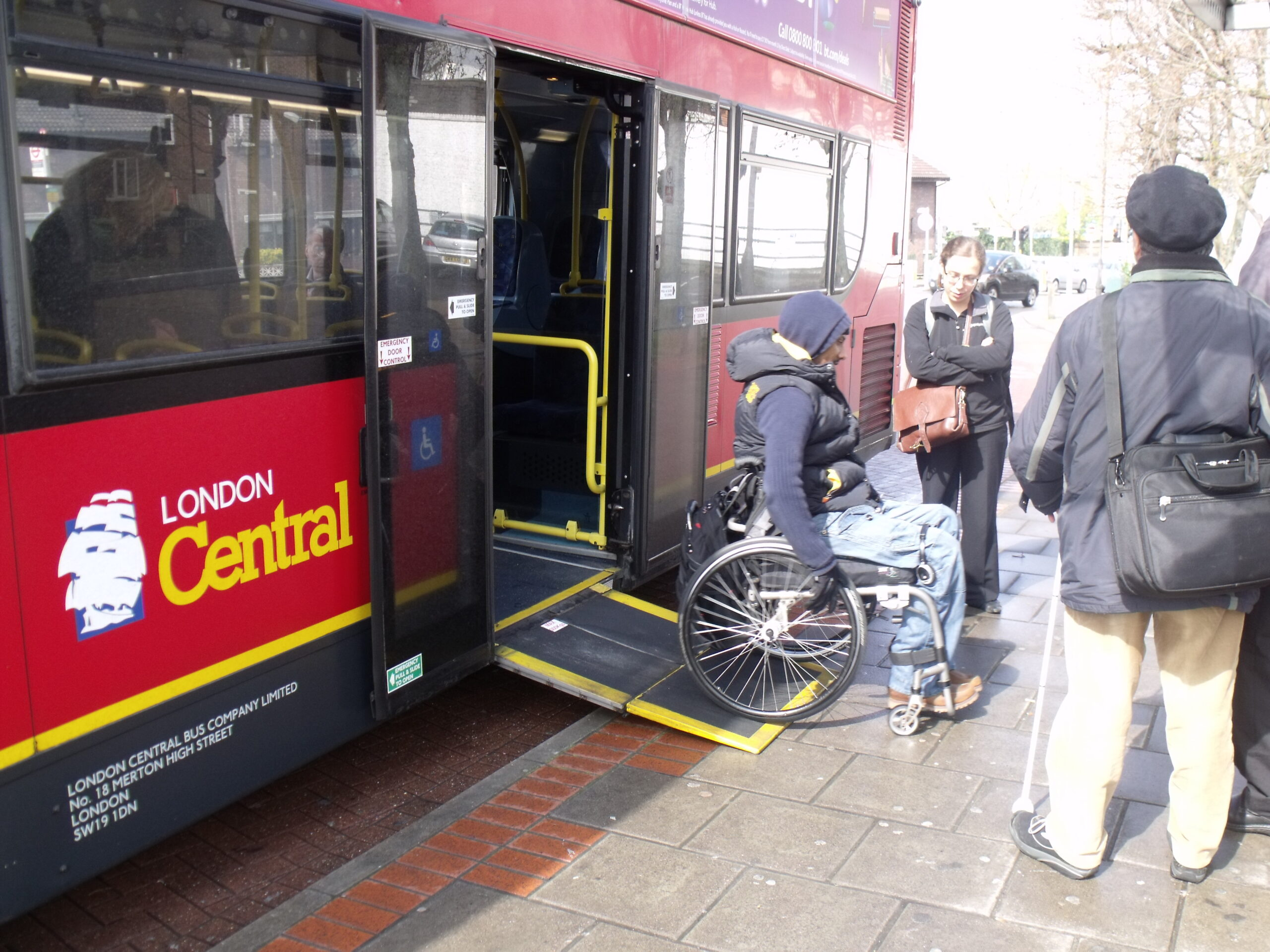 wheelchair user exiting bus