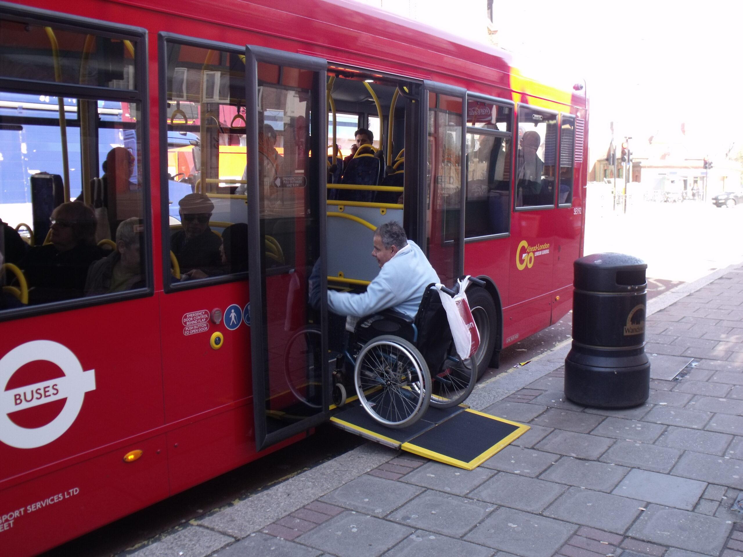 Wheelchair user entering bus