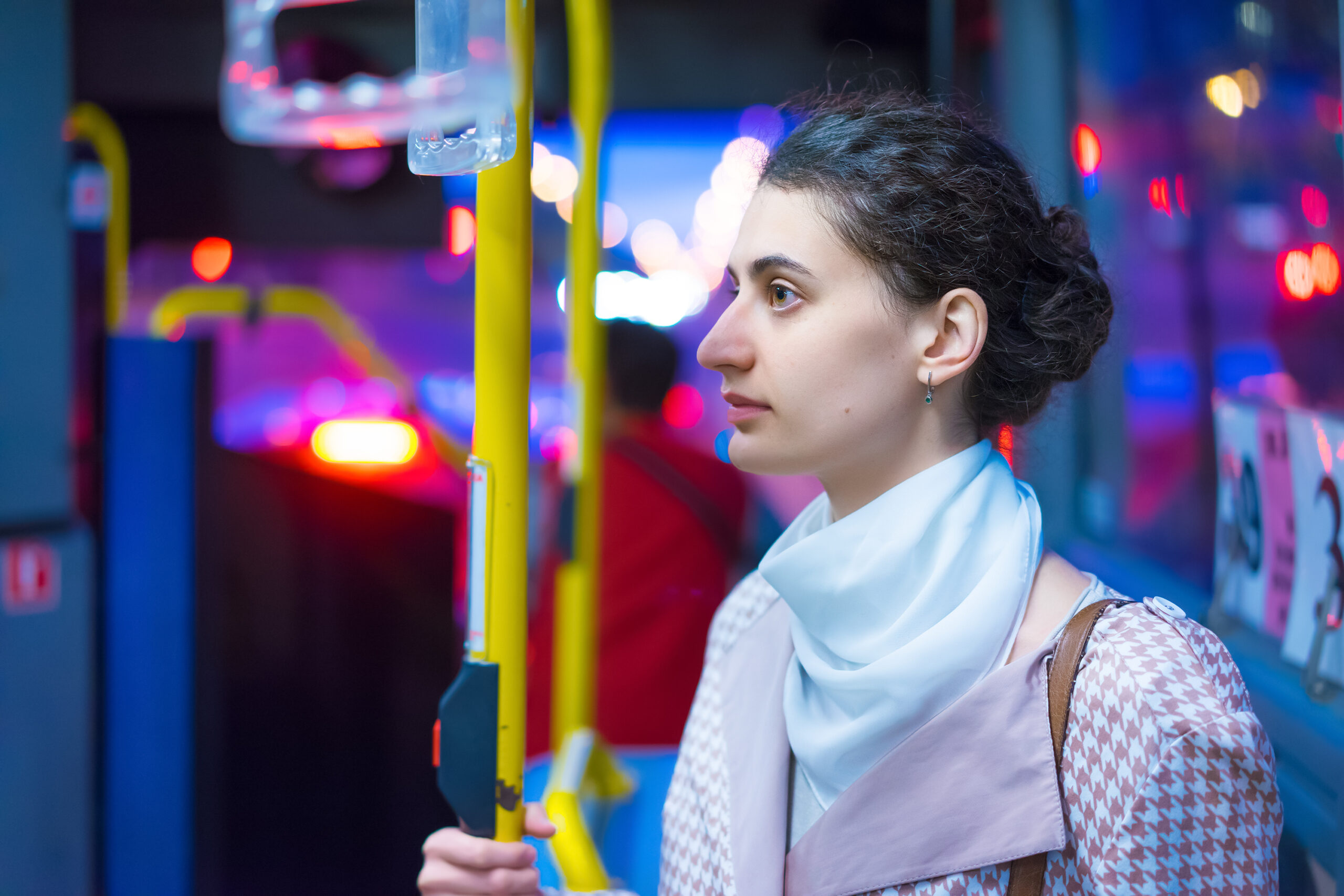 Woman on bus at night